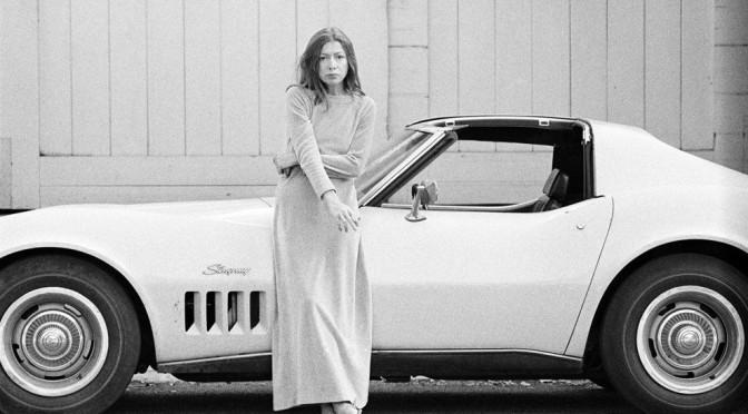Joan Didion in front of car, 1972, Julian Wasser.