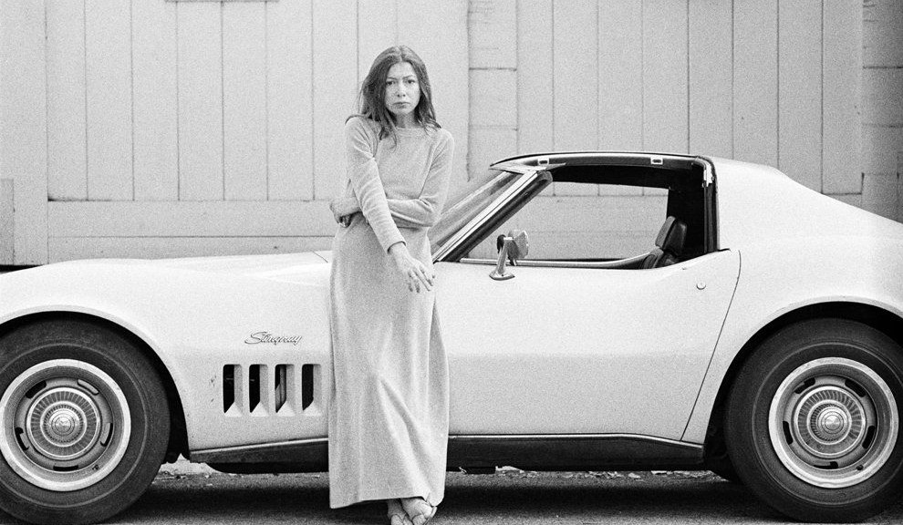 Joan Didion in front of car, 1972, Julian Wasser.
