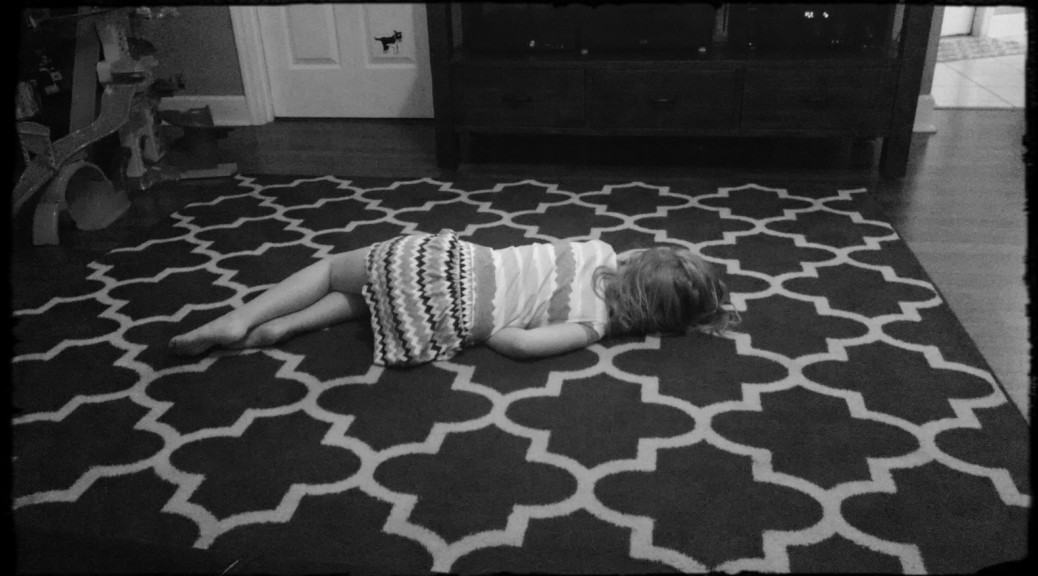 Asleep on the floor.