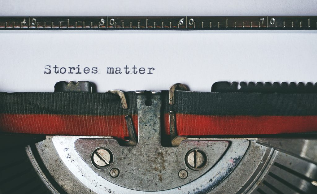 "Close up of type writer with ""stories matter"" typed on the page."